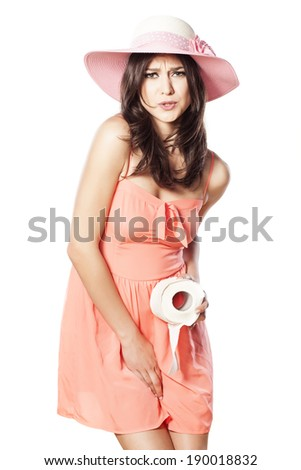 pretty girl with a hat in a short dress has a need for toilet - stock photo