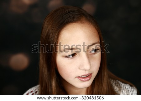 pretty girl with big brown eyes and long brown hair - stock photo