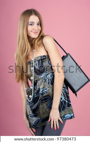Pretty girl with bijouterie against pink background - stock photo