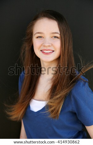 pretty girl with braces smiling