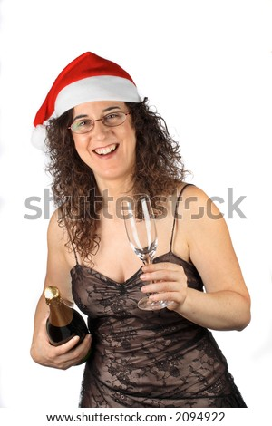 Pretty girl with christmas hat, holding glass and champagne bottle