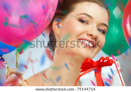 Pretty girl with color balloons - stock photo