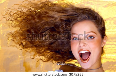 Pretty girl with great fly-away hair. - stock photo