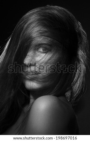 pretty girl with hairs on her face looking at camera monochrome image