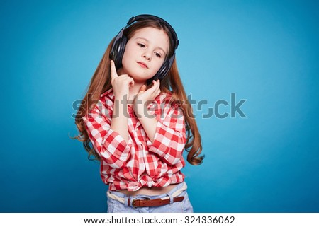 Pretty girl with headphones listening to music - stock photo