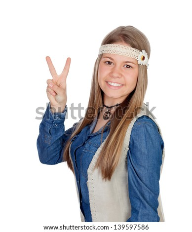Pretty girl with hippie clothes making the peace symbol isolated on white background - stock photo