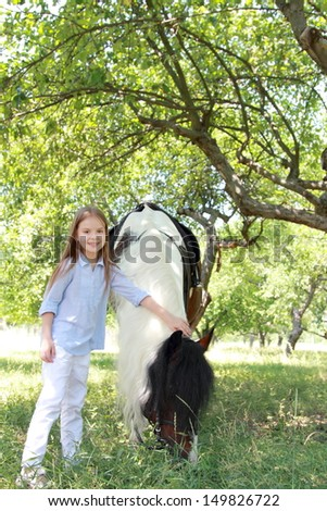 pretty girl with horse - stock photo