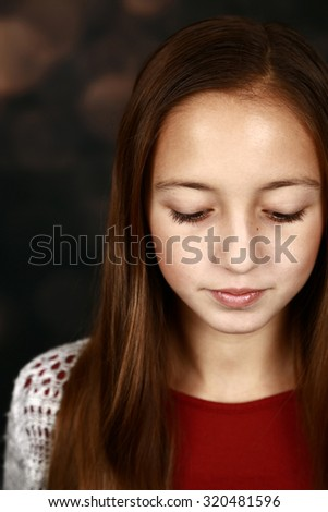 pretty girl with long brown hair looking down