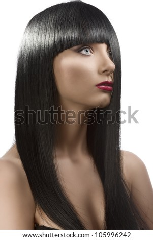 pretty girl with long, dark smooth hair and fringe, she is turned of three quarters at left and her half face is hidden by the hair