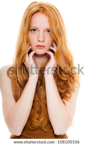 Pretty girl with long red hair wearing brown shirt. Fashion studio shot isolated on white background. - stock photo