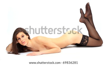 Pretty girl with long slim legs in black nylons. - stock photo