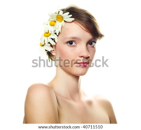 pretty girl with many camomiles against white background