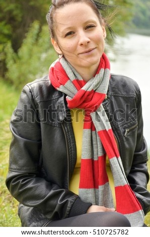pretty girl with red wrap  in nature
