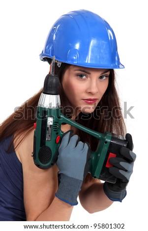 Pretty girl with screwdriver - stock photo