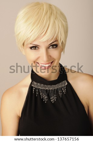 Pretty girl with short pixie light blond hair - stock photo