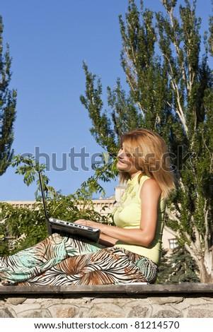 Pretty girl working on laptop - stock photo