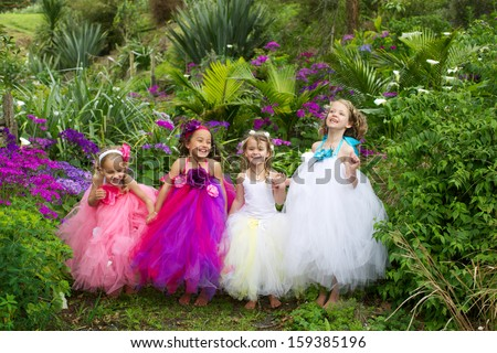 Pretty girls dressed as fairies in the garden. - stock photo