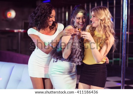 Pretty girls having shots in a nightclub