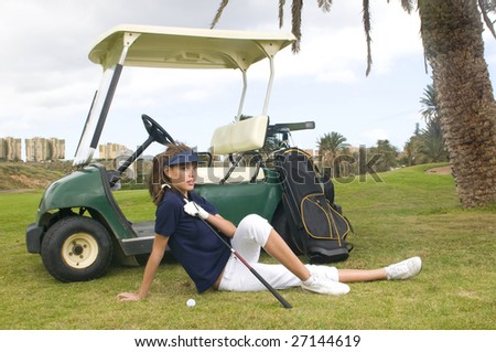 pretty golf player with her golf car
