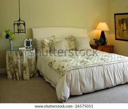 Pretty green bedroom with window and lamp light - stock photo