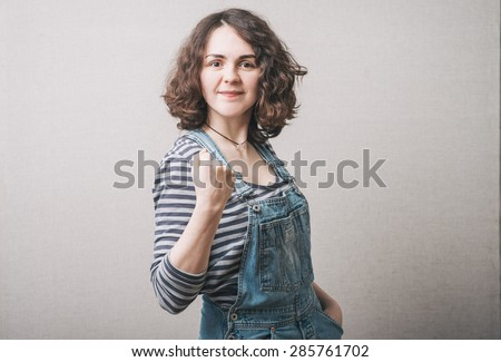 Pretty happy girl with fists - stock photo