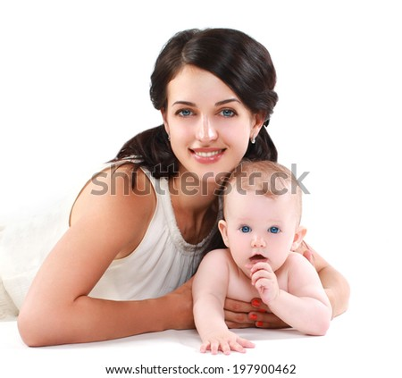 Pretty happy mother and baby - stock photo