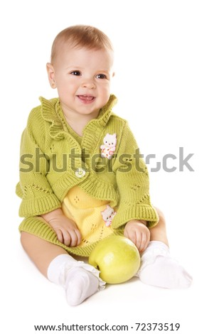 Pretty happy smiling baby girl with green apple isolated on white background - stock photo