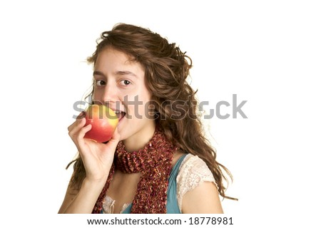 Pretty healthy brunette taking a bite of a apple