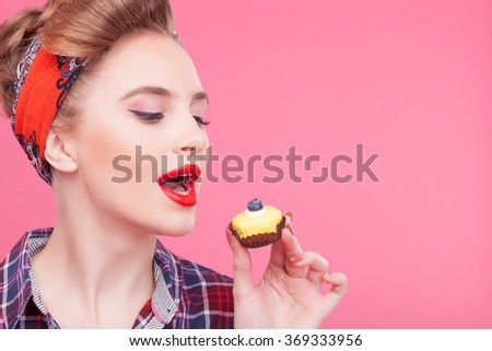 Pretty healthy girl is tasting sweet cake - stock photo