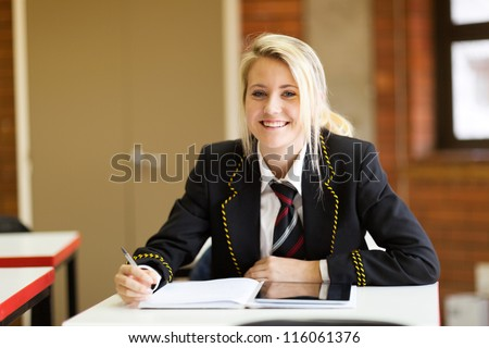 pretty high school student in classroom - stock photo