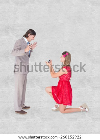 Pretty hipster on bended knee doing a marriage proposal to her boyfriend against white background - stock photo