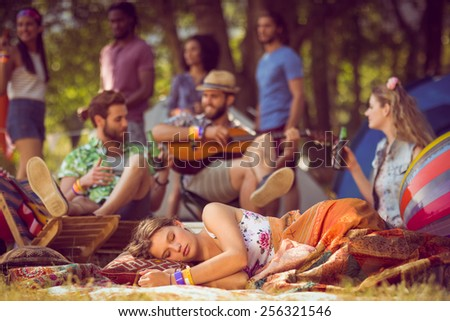 Pretty hipster relaxing on campsite at a music festival - stock photo