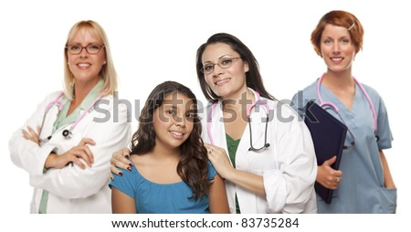 Pretty Hispanic Female Doctor with Child Patient and Colleagues Behind Isolated on a White Background. - stock photo