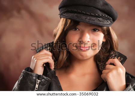 Pretty Hispanic Girl with Hat and Leather Jacket Studio Portrait.