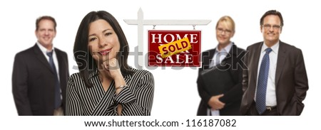 Pretty Hispanic Woman and Other People Behind in Front of Sold Home For Sale Real Estate Sign Isolated on a White Background. - stock photo