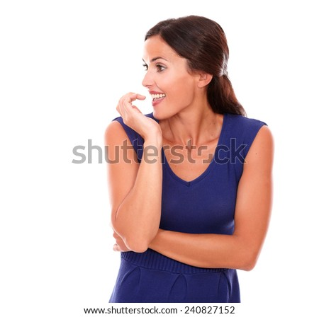 Pretty hispanic woman smiling with excitement while looking to her right smiling in white background - copyspace - stock photo