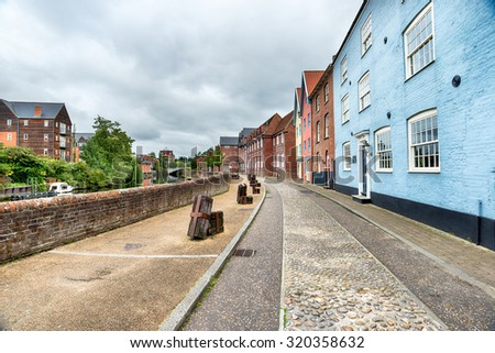 Pretty houses overlooking the river Yare at Norwich in Norfolk - stock photo