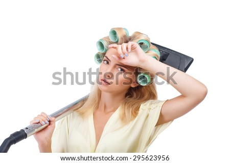 Pretty housewife is having rest after vacuuming. She is tired and exhausted. The girl is wiping sweat from her forehead. Isolated on background - stock photo