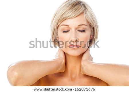 Pretty isolated middle aged spa woman at peace - stock photo