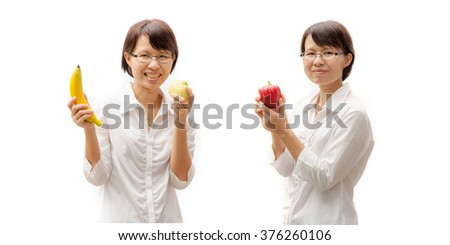 Pretty joyful young woman holding fresh fruits. Healthy lifestyle. Healthy eating. Fruits . Isolated over white. - stock photo