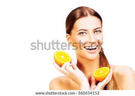 Pretty joyful young woman holding fresh juicy oranges. Healthy lifestyle. Healthy eating. Fruits and vegetables. Isolated over white.  - stock photo