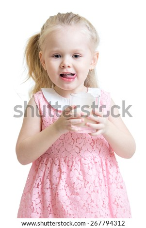 Pretty kid girl drinking milk from glass - stock photo