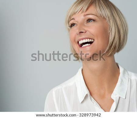 Pretty lady burst into laughter - stock photo