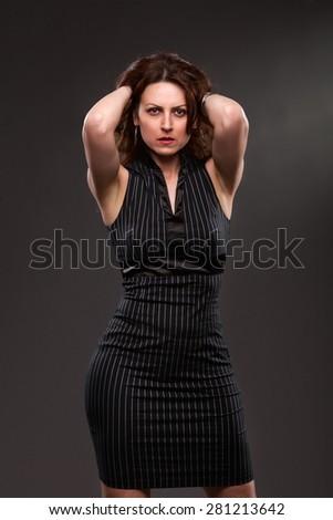 Pretty lady in a elegant black dress posing. - stock photo