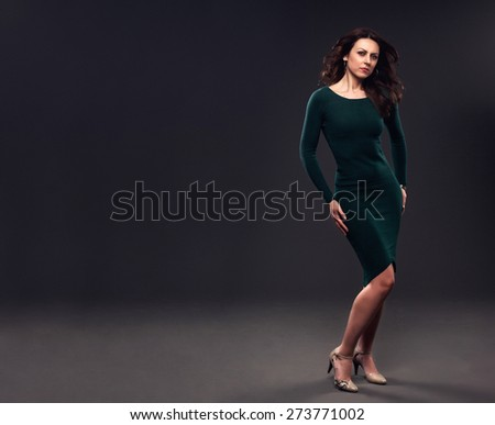 Pretty lady in a elegant green dress, toned photo. - stock photo