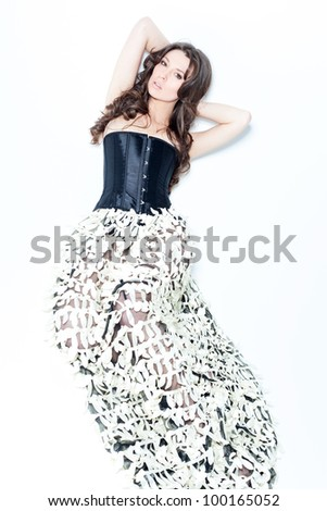 Pretty lady lying over white background - stock photo