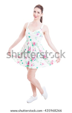 Pretty lady smiling and posing in summer dress studio concept isolated on white background - stock photo
