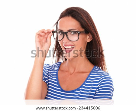 Pretty lady smiling and wearing spectacles while looking at camera, in white background - stock photo