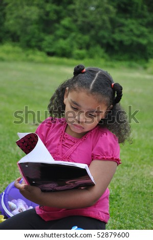 Pretty Latin Preschool Age Girl Reading