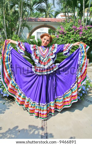 Pretty latin woman with tradition dance clothing - stock photo